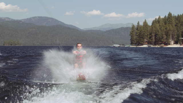 4k uhd: man riding hydrofoil - motorboat stock videos and b-roll footage