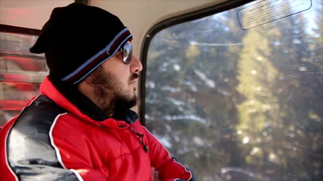 A man riding in a gondola