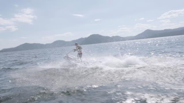4K SLO MO: Man riding jetski on a lake