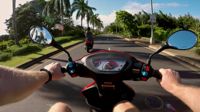 POV of man riding moped around with his wife