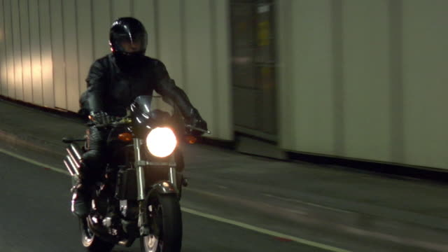 ws zo pov man riding motorbike on road in tunnel / london, uk - fahrzeug fahren stock-videos und b-roll-filmmaterial