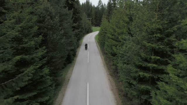man riding motorcycle on road - mountain peak stock videos & royalty-free footage