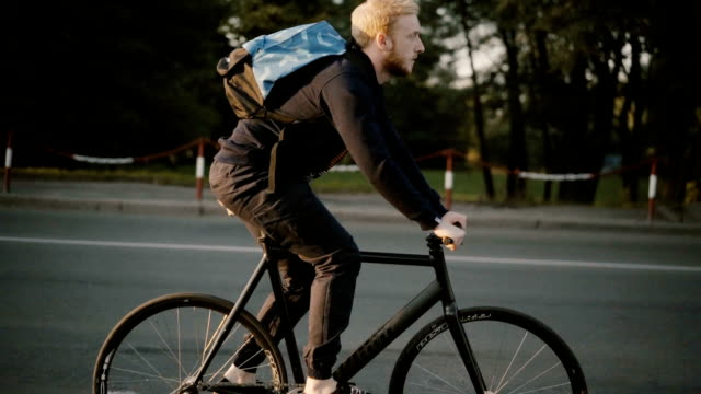 man riding on bicycle - rucksack stock videos & royalty-free footage