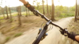 Man riding on mountain bike, cycling personal perspective view