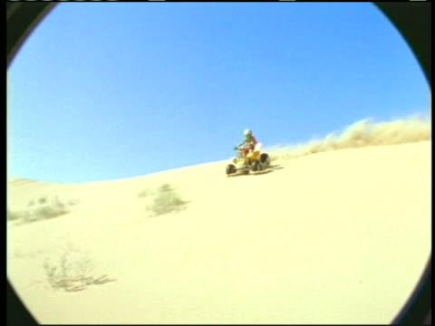 ms, pan, man riding on quad bike over sand dune and crashing, usa - quadbike stock videos & royalty-free footage