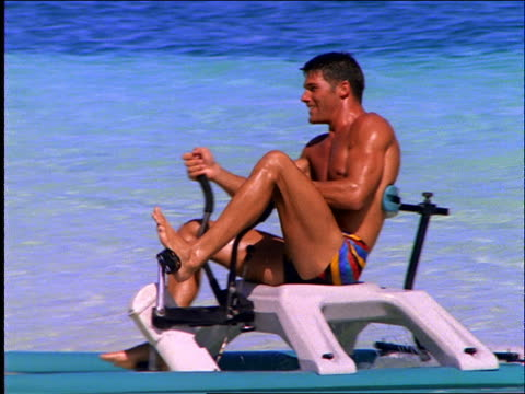 man riding pedalboat on ocean / cancun - 1997 stock videos & royalty-free footage