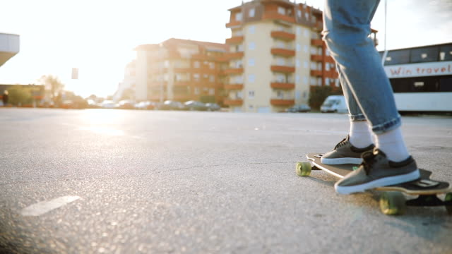 Man riding skateboard on parking lot