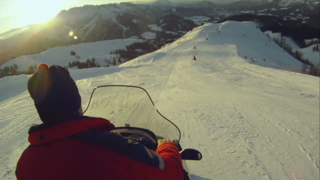 ws pov man riding snowmobile / austria - winter sport stock videos & royalty-free footage