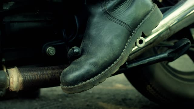 man riding vintage motorcycle. machine details - leather jacket stock videos and b-roll footage