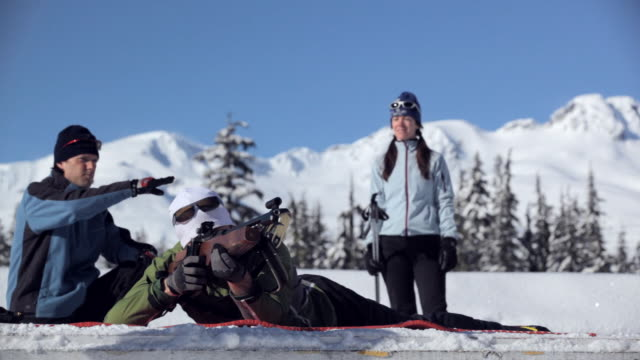 ms pan man rifle shooting and behind instructor and woman talking / whistler ,bc ,canada - biathlon stock videos and b-roll footage