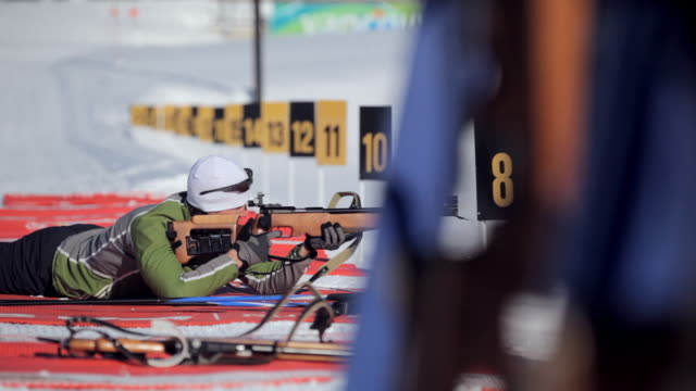 ms pan man rifle shooting in sunny winter day / whistler ,bc ,canada - biathlon stock videos and b-roll footage
