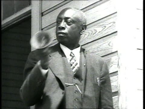 1939 ms man ringing bell on porch outside school - school bell stock videos & royalty-free footage
