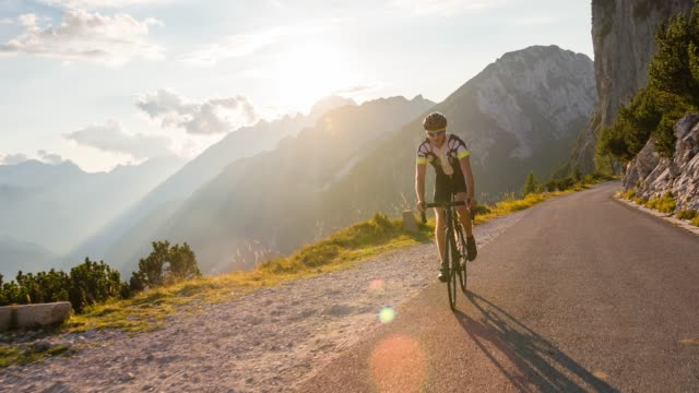 man road cycling on a beautiful sunny day in nature - sports activity stock videos & royalty-free footage