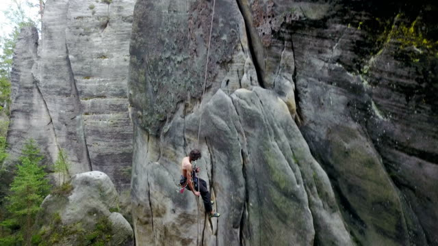 man rock climber rappelling - rope stock videos & royalty-free footage