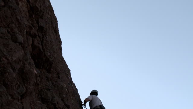 man rock climbing and cheering - argentinian ethnicity stock videos & royalty-free footage