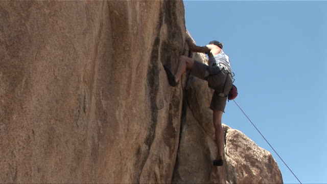 ms zo man rock climbing/ ws man on rock face/ california - joshua tree national park stock videos & royalty-free footage