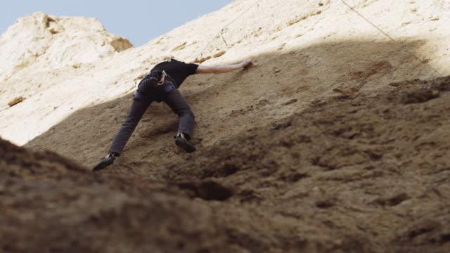 Man rock climbing outside