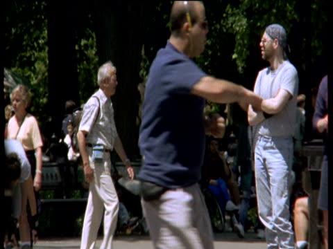 vídeos de stock, filmes e b-roll de man roller-skates in central park - 1990