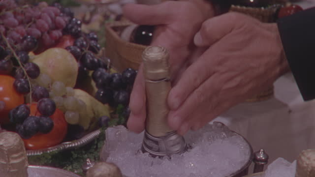 cu man rotating chamaign bottle in ice - bucket stock videos & royalty-free footage