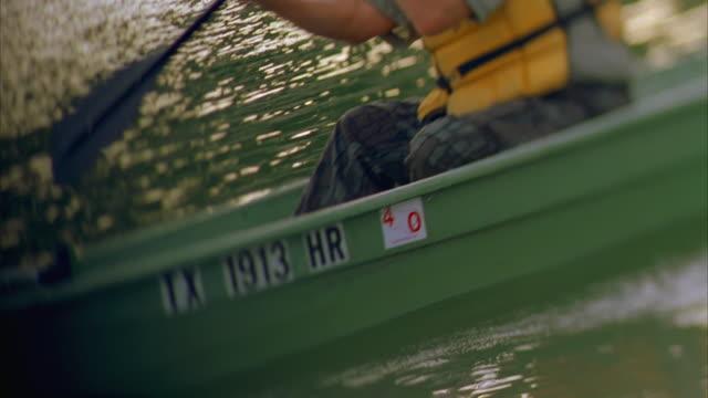ms tu td man rowing boat in river / canyon lake, texas, usa - canyon lake stock videos & royalty-free footage