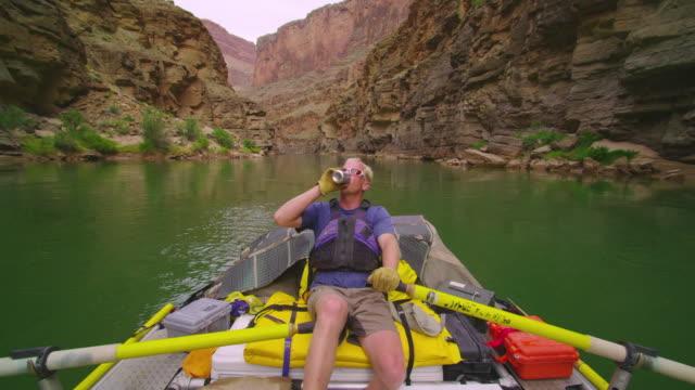 MS POV Man rowing raft down Grand Canyon / Grand Canyon, Arizona, USA