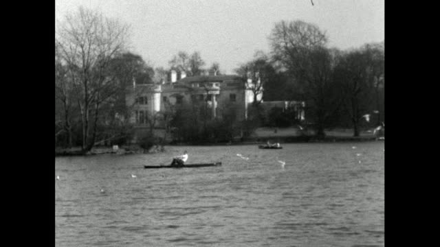 man rows a boat across lake in regent's park; 1956 - one man only stock videos & royalty-free footage