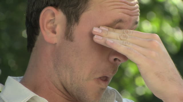 man rubbing his eyes - allergy stock videos & royalty-free footage