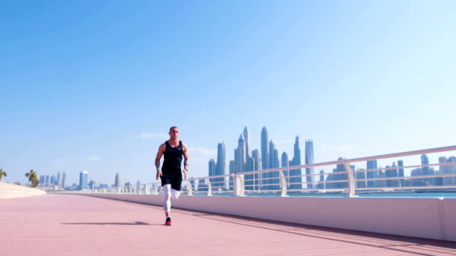 man running and exercise at dubai marina - muscular build stock videos & royalty-free footage