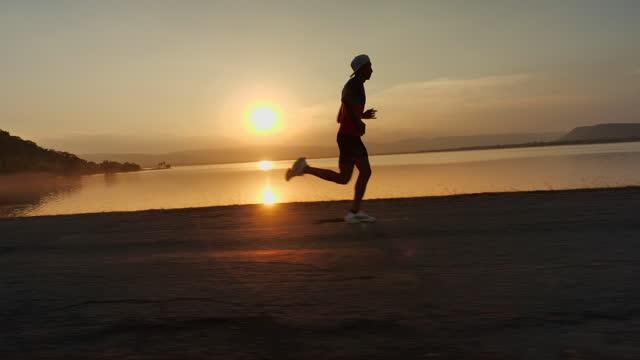 man running at sunset - 1987 stock videos & royalty-free footage