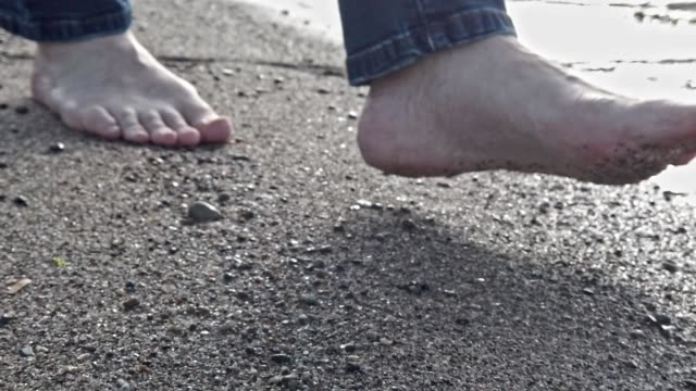 man running barefoot in shallow water on a beach in the sun - tina terras michael walter stock videos & royalty-free footage