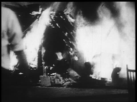 b/w 1932 man running by burning camp of veterans / bonus march / washington dc - 1932 stock videos & royalty-free footage