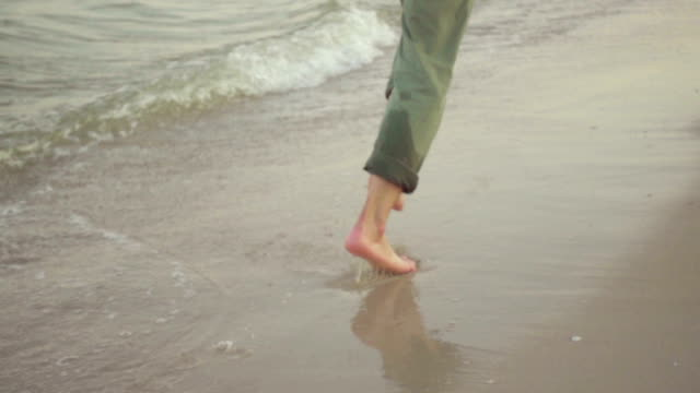 a man running in shallow water at sunset - footprint stock videos & royalty-free footage