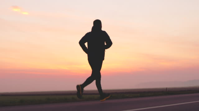 slo mo man running in sunset - full length stock videos & royalty-free footage