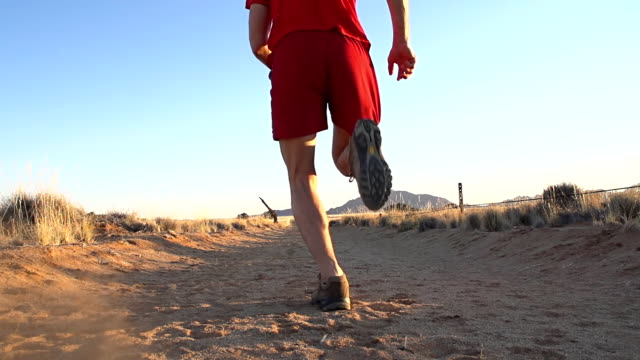 slo mo la man running in the desert - human limb stock videos & royalty-free footage