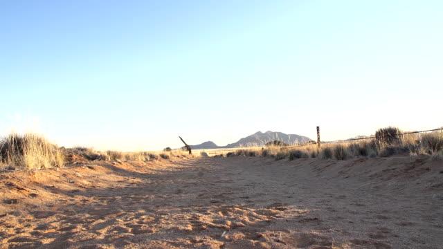 la man running in the desert - human limb stock videos & royalty-free footage