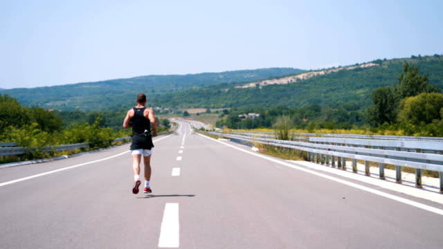 Man running in the middle of road