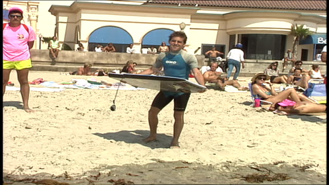 man running into water with boogie board and falling off in oceanside california - oceanside stock videos and b-roll footage