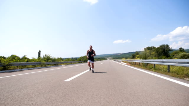 Man running on a highway