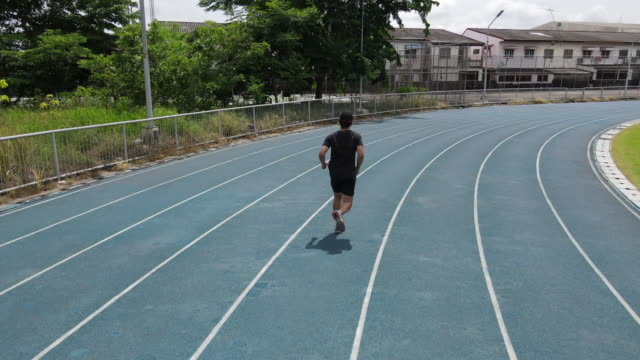 a man running on a sports field treadmill - males stock videos & royalty-free footage
