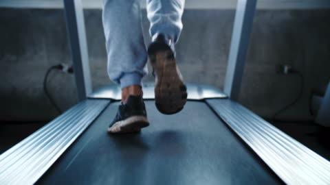 cu : man running on a treadmill - treadmill stock videos & royalty-free footage