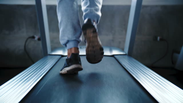 cu : man running on a treadmill - treadmill stock videos & royalty-free footage