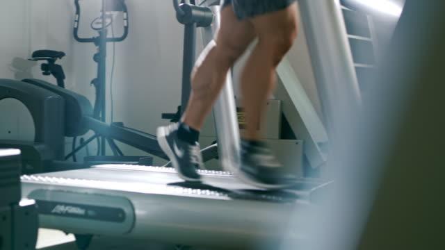 slo mo man running on a treadmill - treadmill stock videos & royalty-free footage
