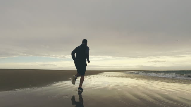 man running on beach. - lockdown viewpoint stock videos & royalty-free footage
