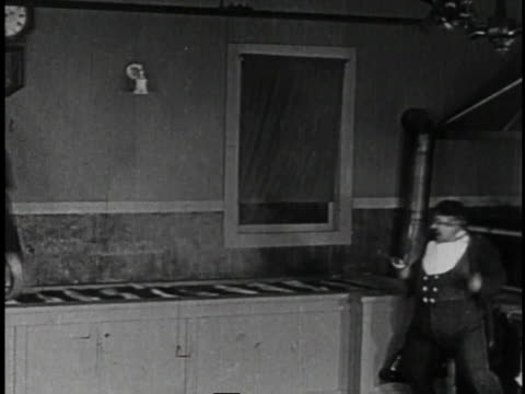 1920 montage man running on conveyor belt and flying off conveyor belt onto table of restaurant patrons - larry semon stock videos and b-roll footage