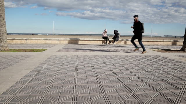 man running on the beach promenade - stock video - promenade stock videos & royalty-free footage