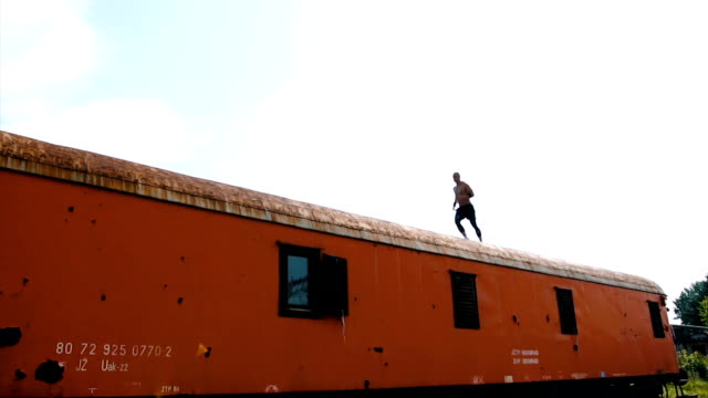 man running on the top of the train - tracksuit bottoms stock videos & royalty-free footage