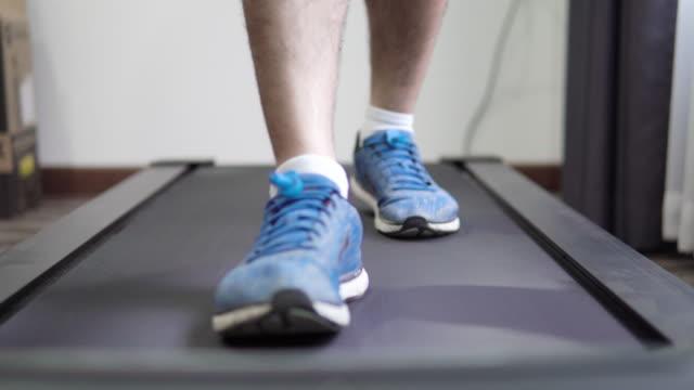 man running on treadmill cardio equipment. - cross trainer stock videos & royalty-free footage