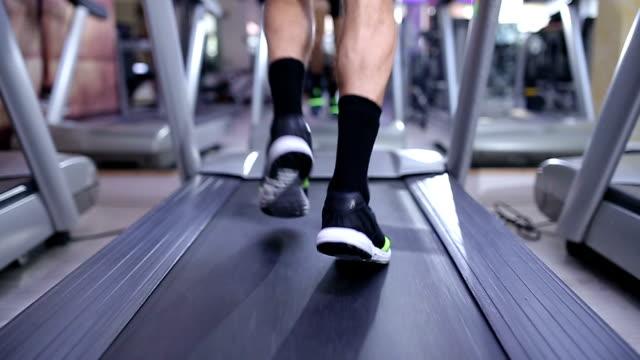 man running on treadmill in slow motion - treadmill stock videos & royalty-free footage