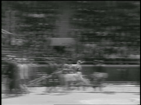 b/w 1933 pan man running + pole vaulting over bar / philadelphia / newsreel - 1933 stock videos & royalty-free footage