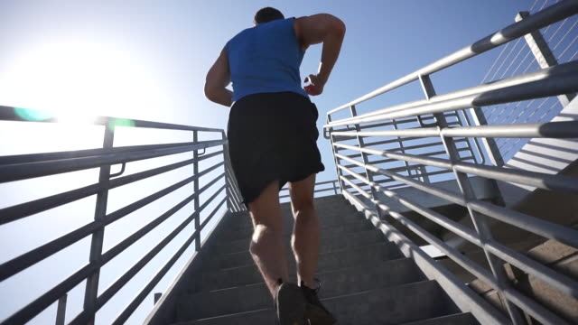 a man running stairs. - slow motion - steps and staircases stock videos & royalty-free footage